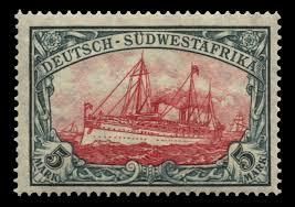timbre représentant un navire dans les tons rouges avec légende en noir 5 Mark et texte Deutsch Südwestafrika