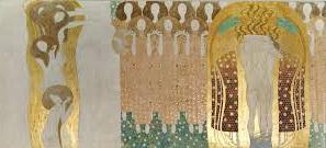 Le deuxième panneau, tout en longueur, montre d'abord, à droite, cinq danseuses nuesen pyramide dans un halo d'or, qui tendent les bras vers une chorale de femmes habilléesde robes ocres ondulantes. Elles sont très regroupées, se tiennent les mains et ont les yeux fermés. En dessous d'elles, une prairie de fleurs blanches très simple. Tout à gauche, un couple nu se tient enlacé dans un baiser sur un fond doré.