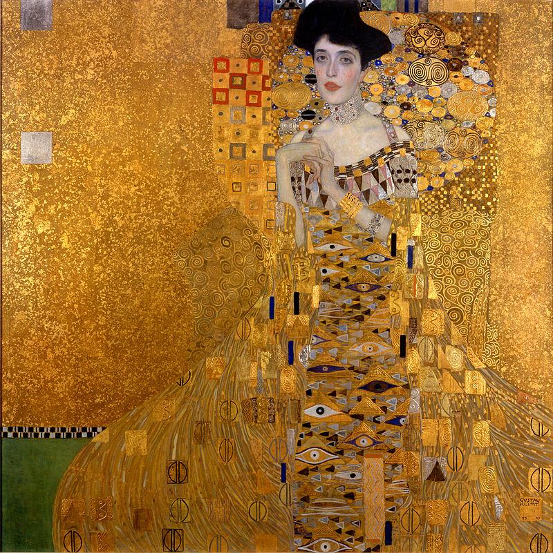 Une femme se tient sur un fond d'or. Elle nous regarde, les joues roses, elle se tord les mains. Sa robe est également en or, recouverte de motifs d'yeux et partant d'elle comme une spirale.